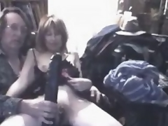 What do you think this insane mature wench feels, when huge darksome sex toy permeates her big stretched cunt?