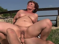 Older bbw Manyika with shaved fur pie bonking with young boyfriend at the open air
