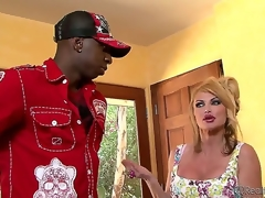 Taylor Wane and her hubby Gabriel Dalessandro were in the middle of having lunch when the doorbell rang. It was Jon Jon, and she shamelessly started sucking his black ramrod right there!