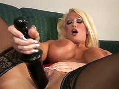 Alura Jenson looks admirable in these thigh high, jetblack stockings. However, that babe looks even greater quantity excellent with that 14 inch dark fake penis pounding her pussy, making her D mambos bounce.