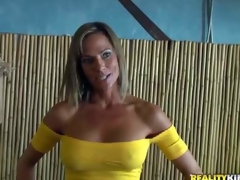 Shes a beautiful MILF with big fake milk shakes and slim figure. Leggy well stacked woman in yellow blouse and blue skin constricted jeans turns man on. MILF Hunter can't resist! This babe is devilishly sexy