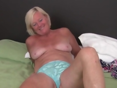 Cute freckled mature golden-haired masturbates