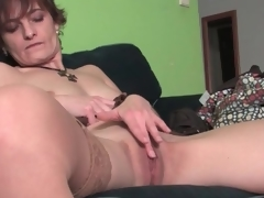 Cute milf gently rubs her beautiful muff