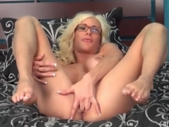 Big fake titty babe Puma Swede sits on toy