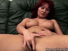 Filthy redhead MILF with massive boobs goes horny on the couch