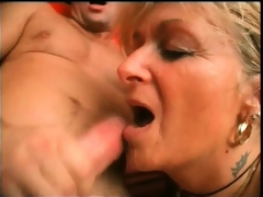 Lustful golden-haired aged whore widens her legs and gets her wet
