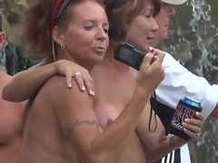 Milfs hanging out topless during Dream Fest