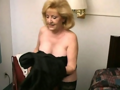 Lewd blonde grandma Kitty Fox stripping and showing her hawt decolletage